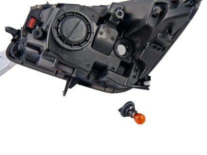 Reflektor xenon w zestawie z żarówkami H11 / PY21W - Opel Insignia